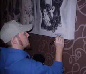 Darren putting the finishing touches. Rock legends insitu commission. Darren Graham of Ephraim Art Studio